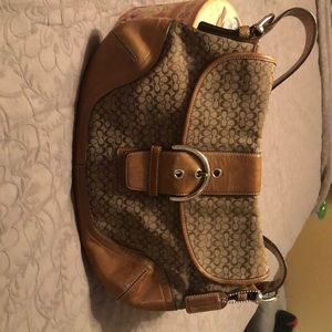 Leather and monogram Coach bag.
